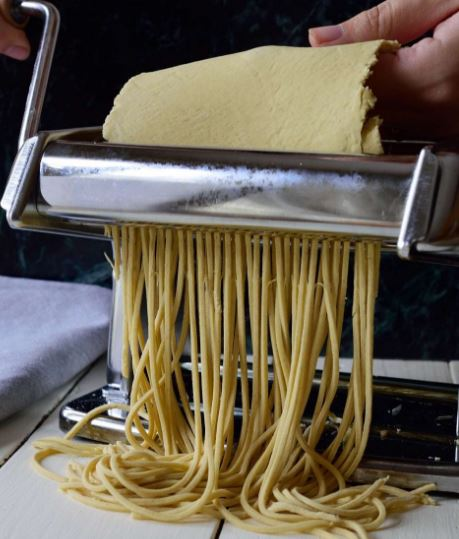 rolling-pasta-into-spaghetti.jpg