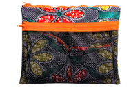 Printed in vibrant African print, this holdall pouch is a MUST HAVE! a lightweight cotton piece is with 2 compartments a main one with waterproof lining perfect for your book when youre at the beach, or your tablet and the front compartment has a net with neon zip for items that you want to air dry. Perfect for weekends away or carrying your bikinis or stationery or wash bag on vacation.   - Multicolored cotton fabric - Neon Zip fastening on top - Mesh front with neon zip for extra pockets and can be used for wet swim suits that need to air dry - Waterproof interior  - African print - Made in West Africa