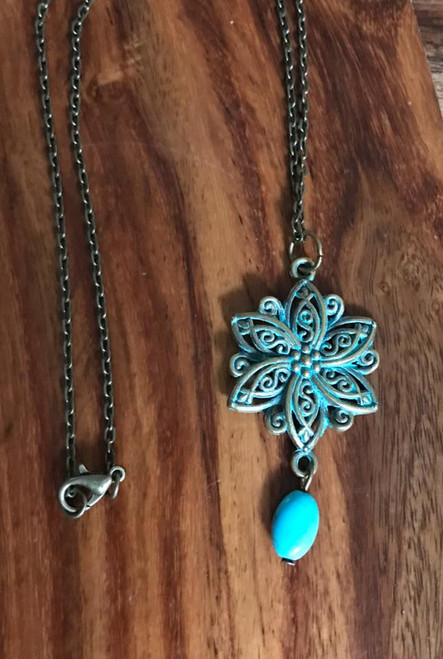 Resell for 12.00 or more 18 inch antiqued brass chain Brass patina flower pendant with reconstituted turquoise. Style #ABFN021018g