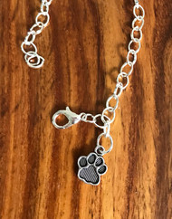 Resell for 12.00 or more  Pewter paw print
