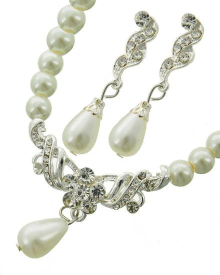 """resell for 27.00 or more Silver Tone / White Synthetic Pearl & Clear Rhinestone / Lead Compliant / Post (earrings) / Necklace & Earring Set  •   LENGTH : 18 1/2"""" + EXT •   PENDANT : 1 1/2"""" X 1 1/4"""" •   EARRING : 3/8"""" X 2""""  •   SILVER/WHITE Style #PCBS031218g"""