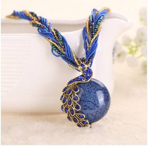 resell for 18.00 or more 18 inch cord/seed bead necklace Antiqued brass peacock blue crystal and resin 2 inch ext chain. Style #BP032818g