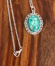 Resell for 25.00 or more 29 inch silver tone chain Teal kaleidoscope acrylic, pewter bezel Style #TKAN041218
