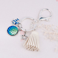 "resell for 15.00 or more Mermaid Fish /Dragon Scale Keychain & Keyring Silver Plated & Silver Tone Off-white & Blue AB Color Faux Suede Tassel Star Clear Rhinestone 94mm(3 6/8"") x 30mm(1 1/8"") Style #MFTK042618"