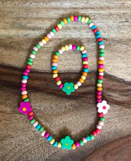 Resell for 15.00 or more Wood stretch children's flower necklace and bracelet. Colors may vary Style #CMCWN042718