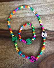 Resell for 15.00 or more Wood stretch children's lady bug necklace and bracelet. Colors may vary Style #CLWN042718