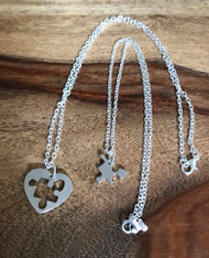 Resell for 18.00 or more Necklace set 20 inch silver tone w heart puzzle cut out pewter 18 inch silver tone w puzzle piece pewter Autism awareness Style #AAHPNS050118