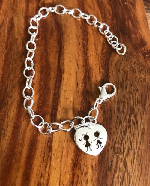Resell for 12.00 or more 7 3/4 inch charm bracelet Pewter boy and girl heart Style #BGCB051718