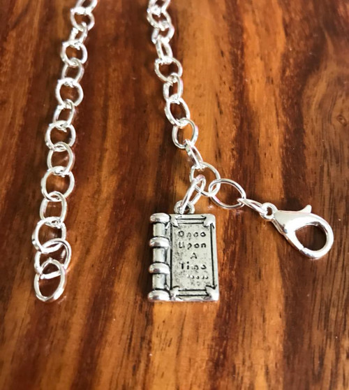 Resell for 12.00 or more 7 3/4 inch charm bracelet Pewter story book  Once upon a time Style #OUTB051718
