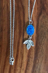 Resell for 12.00 Or more 30 inch silver tone chain Bright blue drusy with pewter leaf pendant Style #BBDN051818