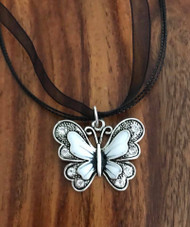 "Resell for 15.00 or more Pewter enameled white black butterfly/ crystal. 1 3/8 x 1 1/8"" 17 inch black organza necklace w/ ext chain Style #BWBN061518"