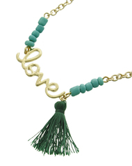 """resell for 27.00 or more Gold Tone / Green Seed Beads & Thread / Lead Compliant / Metal / Valentine's Day / Mother's Day / Love W/tassel Charm / Necklace /  •   LENGTH : 16"""" + EXT •   PENDANT : 1"""" X 1 1/4"""" •   CHARM : 1 1/4"""" •   GOLD/GREEN  Style #TGLTN061818"""