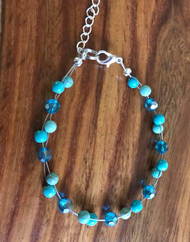 Resell for 15.00 or more 7.5 inch floating bracelet plus ext Turquoise magnesite and crystal  Made by Ashley Style #TMCFB062618