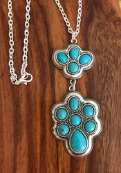 "Resell for 21.00 or more 20 inch silver tone chain  Pewter and turquoise magnesite pendant •   WIDTH X LENGTH : 1 1/4"" X 3 13/4  Style #TON062818"
