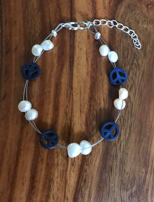 Resell for 15.00 or more  Pearls and peace signs Genuine fresh water pearls. Howlite peace signs baby blue. 7.5 inch floating bracelet plus extender Made by Ashley Style #PPSFB070318