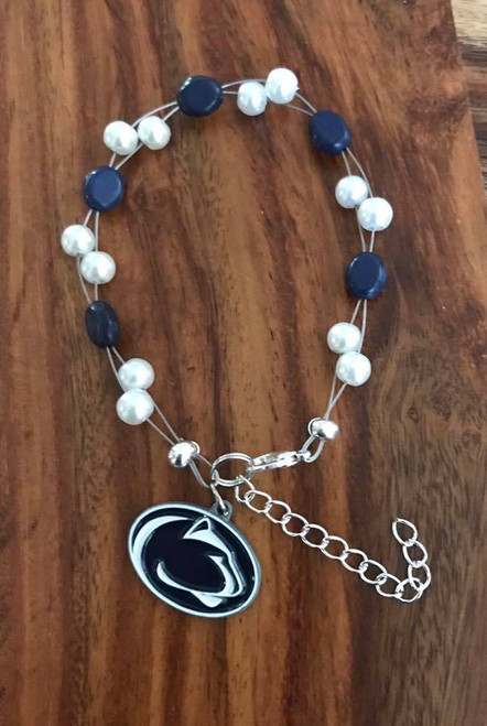 """Resell for 40.00 or more  7.5"""" plus ext chain floating bracelet Official licensed Penn State Lions Charm  Made by Ashley Style #PSOB080718"""