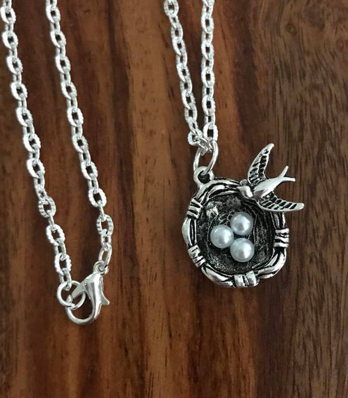 "Resell for 12.00 or more  20"" silver tone chain  Pewter bird w nest and eggs Style #BNN080918"