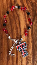 "Resell for 40.00 or more 7.5"" plus ext chain Made by Ashley  Texas Tech team colors  W official charm Style #TTOLB081518"