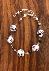 """Resell for 18.00 or more 7.5"""" plus ext floating bracelet  Made by Ashley  Purple ceramic w purple glass and crystal Style #PCFB082918"""