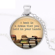 resell for 15.00 or more 20 inch silver tone chain A book is a dream you can hold in your hands pendant Style #BDP083118