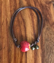 Resell for 9.00 or more Bracelet / anklet adjustable cording Brown cord, red ceramic heart, bells fits 7 to 10 inches Style #RCHBBA091118