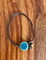 Resell for 9.00 or more Bracelet / anklet adjustable cord  Brian cord, blue ceramic, bells Fits 7 to 10 inches Styles #BCBCBA091118