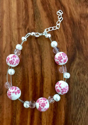 Resell for 18.00 or more 7.5 inch plus ext floating bracelet  Pink white ceramic / pink glass / white glass pearls Style #PCFB091418