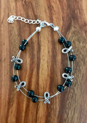 Resell for 21.00 or more (1.00 is donated) 7.5 inch plus ext floating bracelet  Pewter awareness ribbon / black glass Style #BKARFB091418