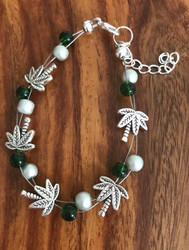 "Resell for 18.00 or more 7.5"" floating bracelet plus extender Pewter palm tree w green glass and matte silver glass pearl Made by Ashley Style #PTFB092418"