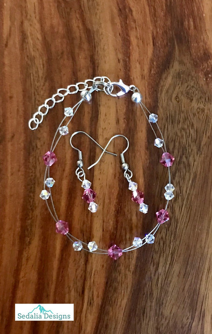 "20.00 resell for 60.00 or more Swarovski crystal. October Birthstone Rose  crystal w Clear AB  7.5"" plus ext Bracelet and Earring set Surgical steel ear wires Made by Ashley  Style #OCTSFBS110218"