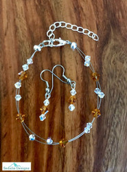"20.00 resell for 60.00 or more Swarovski crystal. November Birthstone Topaz crystal w Clear AB  7.5"" plus ext Bracelet and Earring set Surgical steel ear wires Made by Ashley  Style #NOVSBFBS110218"