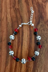 resell for 24.00 7.5 inch floating bracelet plus ext Black and red glass Lady Bug Bracelet Style #LBFB111318