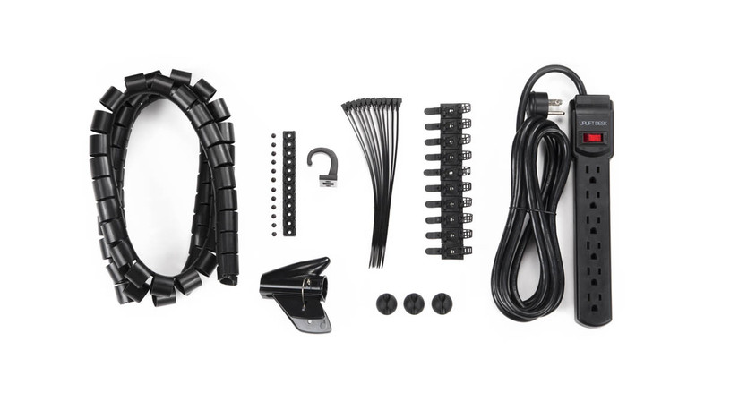 Kit comes with a basic surge protector, 10 adhesive cable mounts, 12 screw-in cable mounts, 12 reusable cable ties, cable organizer, accessory hook, and hardware