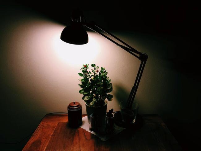 Table lamp in dark room