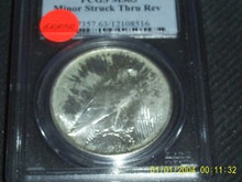 1922 Peace Dollar MINT ERROR PCGS MS 63 Struck Thru Rev