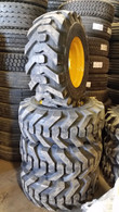 (4-Tires with Wheels) New Holland LS 180 - 230 skidsteer tire size 14-17.5 14175