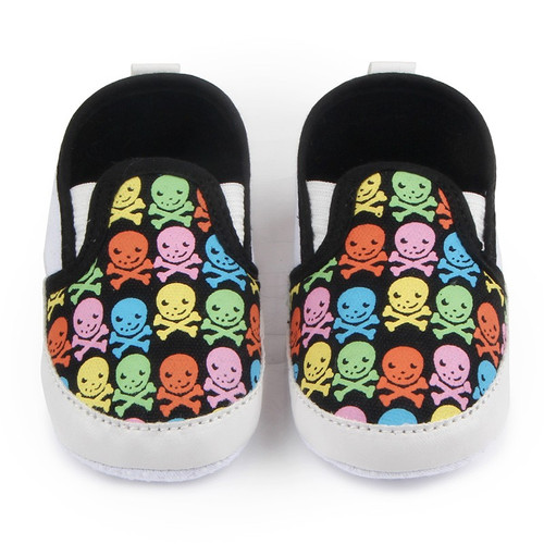 colorful skulls baby shoes, baby skull and crossbones shoes, pirate baby shoes, rock and roll baby shoes, baby gift for cool new parents, badass baby shoes, multi colored skull shoes for infants, skull canvas baby shoes, cool baby shoes