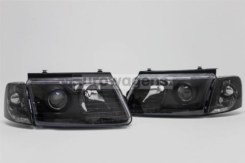 Projector headlights set with indicators black VW Passat B5 97-00