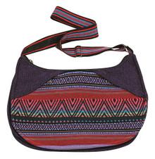 2 zipper pockets on a uniquely shaped bag - adjustable strap - zipper close