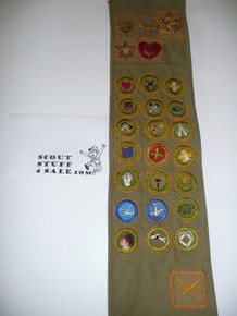 1940's Boy Scout Merit Badge Sash with 21 tan crimped merit badges (2 are Air Scout), 5 rank badges with pins, 1 scribe patch and a Houston KRS