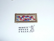 Eagle Scout Award Knot on tan with a khaki bdr, 1980's
