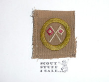 Signaling - Type A - Square Tan Merit Badge (1911-1933), reversed flags, black striped back, used