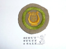 Music - Type B - Wide Crimped Bdr Tan Merit Badge (1934-1935), was sewn but in very good condition