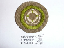Lifesaving - Type B - Wide Crimped Bdr Tan Merit Badge (1934-1935), was sewn but in very good condition