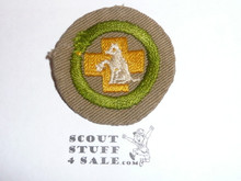 First Aid to Animals - Type B - Wide Crimped Bdr Tan Merit Badge (1934-1935), was sewn but in very good condition