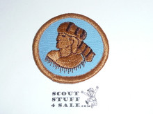 Frontiersman Patrol Medallion, Blue Twill (tan man) with plastic back, 1989-2002
