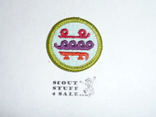 Skating (bright colors)- Type H - Fully Embroidered Plastic Back Merit Badge (1971-2002)