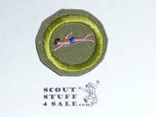 Swimming (pink swimmer) - Type E - Khaki Crimped Merit Badge (1947-1960)