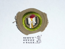 Scholarship - Type B - Wide Crimped Bdr Tan Merit Badge (1934-1935)