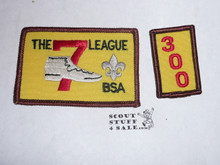The 7 League High Adventure Team (HAT) Award Patch, 300 nights segment, rolled edge